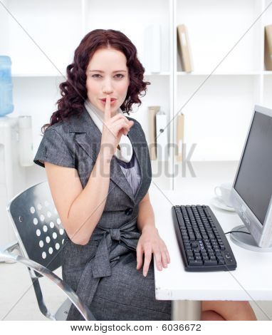 Businesswoman Shushing With Her Finger In Office
