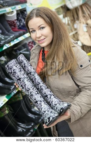 Satisfied Customer With Watertights In The Hands Is In Shop