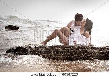 young sexy couple kisisng on beach poster