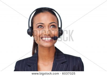 Beautiful Ethnic Businesswoman With A Headset On Looking Upwards