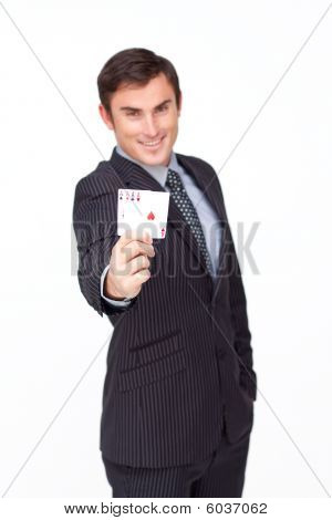 Attractive Businessman Holding Four Aces