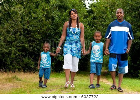 Family Is Walking In Nature