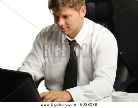 The Young Businessman On A Workplace