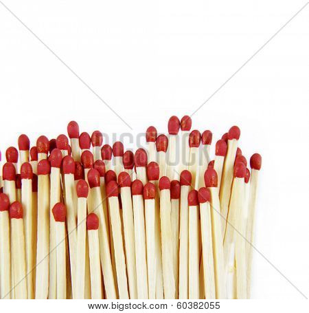 Pile of matchsticks on white