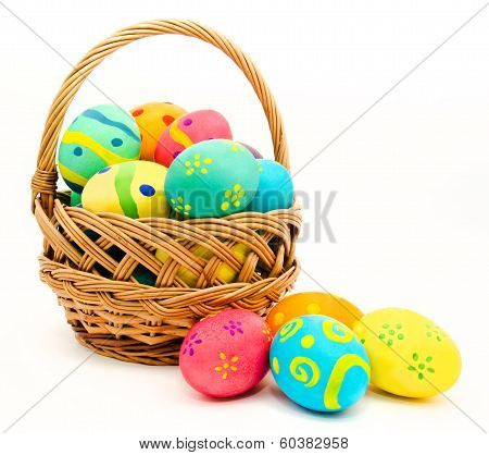 Colorful Easter Eggs In The Basket Isolated On A White