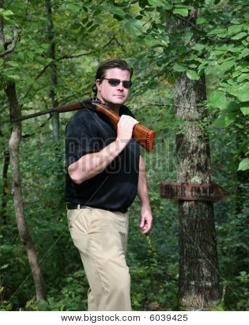 Man Carrying A Shotgun
