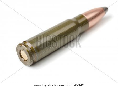 Old intermediate rifle cartridge isolated on white