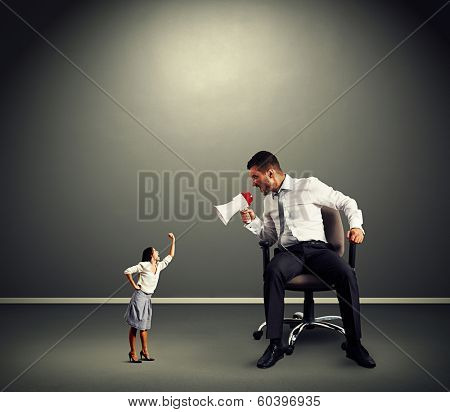 quarrel between man and woman over dark background