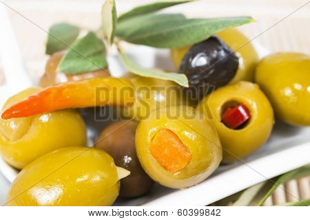 The Stuffed Olives With An Olive Branch Lie On A Plate, Closeup