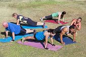 foto of rep  - Diverse group of adults in boot camp fitness class - JPG