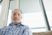 pic of button down shirt  - Portrait of senior man relaxing in living room - JPG