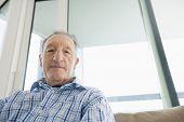 image of button down shirt  - Portrait of senior man relaxing in living room - JPG