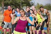 pic of enthusiastic  - Enthusiastic bootcamp fitness instructor with group outdoors - JPG