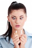 image of non-toxic  - Young woman breaking cigarette over white background  - JPG