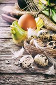 stock photo of quail egg  - Rustic table setting with quail eggs for Easter holiday