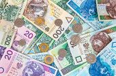 picture of zloty  - Background made of polish banknotes and coins  - JPG