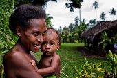 Melanesian mother and baby in Luganville, Vanuatu