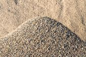 stock photo of sand gravel  - Detailed image of a sunny heap of sand and gravel in varied colors and shapes - JPG