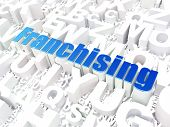 Business concept: Franchising on alphabet background