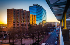 stock photo of pov  - View of buildings along 11th Street at sunset in downtown Wilmington Delaware from the City Center Parking Garage. ** Note: Visible grain at 100%, best at smaller sizes - JPG