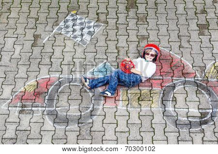 Little Boy Having Fun With Race Car Picture Drawing With Chalk