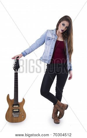 Beautiful teenage rebellious blond confident rocker girl standing with electric guitar