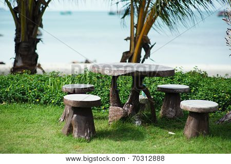 Beach Garden With Wooden Table And Chairs - Gardening And Landscaping