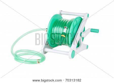 garden hose coiled with spray nozzle