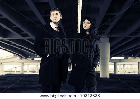 Young fashion couple under highway road intersection
