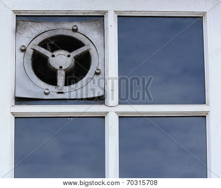 Old Electric Air Fan Or The Ventilator On A Window