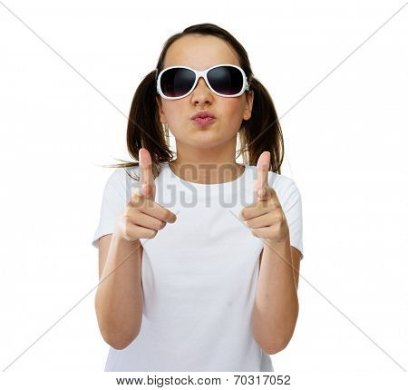 Smiling pretty young girl with her brown hair in pigtails wearing trendy sunglasses and giving the camera a friendly smile, on a white studio background