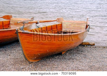 Rowboat At The Edge Of The Lake