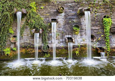 Rocky Wall With Small Waterfalls In Planten Un Blomen Park
