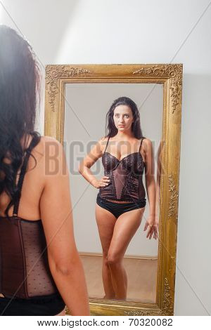 Mirror image of a woman in lingerie