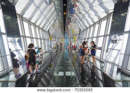 SHANGHAI, CHINA - JUNE 16, 2014: Tourists enjoy the Jin Mao Observation deck in Shangai. The building was Shanghai's tallest until 2007.