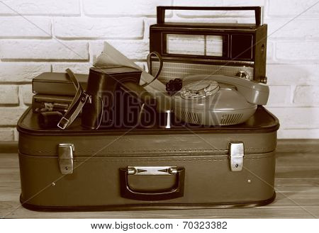 Old travel suitcases with retro things, close up