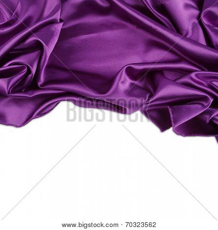 Closeup of purple silk fabric on white background