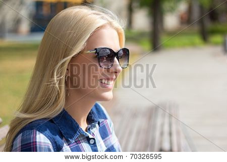 Portrait Of Young Attractive Woman In Park