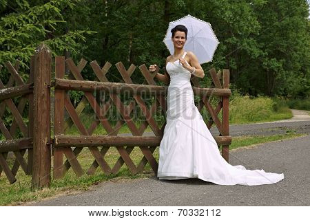 Young bride with sunshade