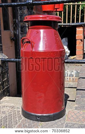 Red milk churn.