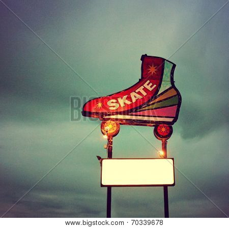 a skating neon sign toned with a vintage retro instagram filter