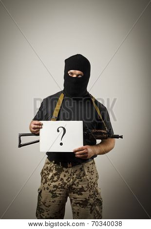 Gunman Holding White Paper With Question-mark.