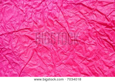 wrinkled pink paper as background