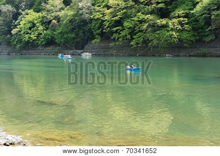 KYOTO, JAPAN - APRIL 26th  : Boats in Hozu(Katsuragawa)  River in Arashiyama in Kyoto, Japan on 26th April 2014.