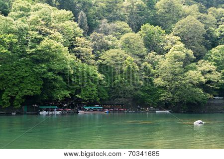 KYOTO, JAPAN - APRIL 26th  : Geen water and boats at the shore of Hozu (Katsuragawa) River in Arashiyama in Kyoto, Japan on 26th April 2014.