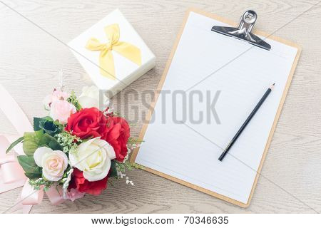 Wooden Clipboard Attach Planning Paper With Pencil Beside Rose Bouquet ,gift Box On Table