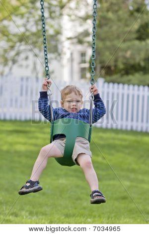 Nervous Boy On Swing