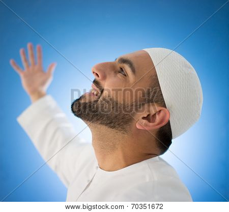 Arabic young man posing with hands in air