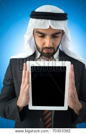 Arabic young businessman posing with tablet for copy space