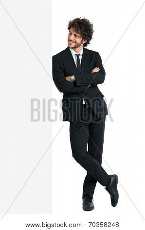 Young Elegant Man With Armcrossed Looking At Billboard Isolated On White Background